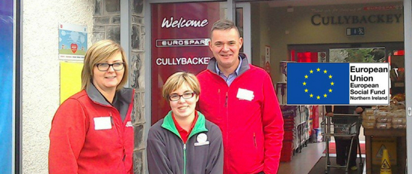 images shows three people standing outside a Spar shop - one of them is a job match programme participant.  There is also the copy of the European Social Fund Logo.