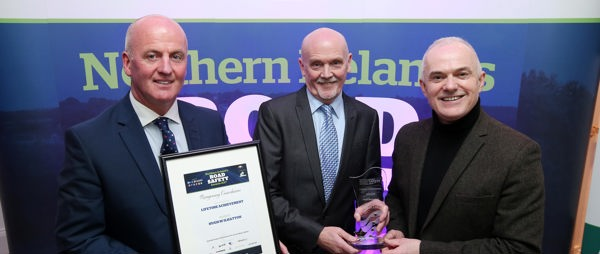 Hugh McIlhatton receiving his lifetime achievement award at Northern Irelands Road Safety awards by Frank Mitchell and Davy Jackson