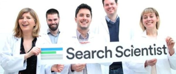 four people in lab coats holding a seatch scientist banner